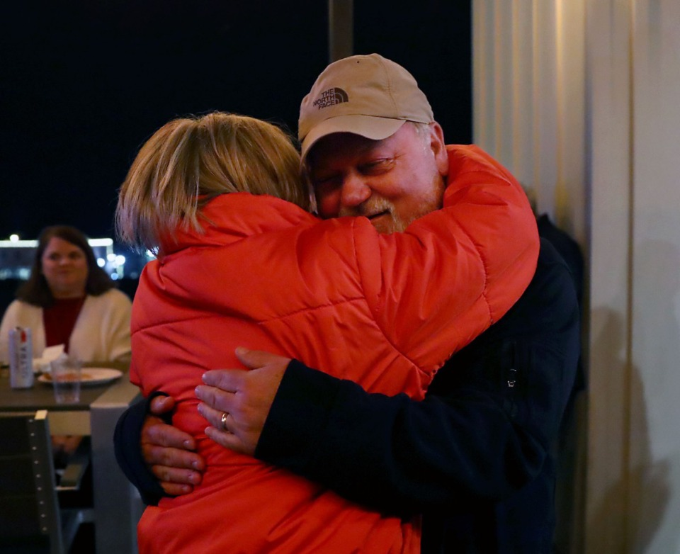 <strong>John Worley hugs Missy Marshall during a runoff-election night watch party in Collierville on Dec. 8.</strong> (Patrick Lantrip/Daily Memphian)
