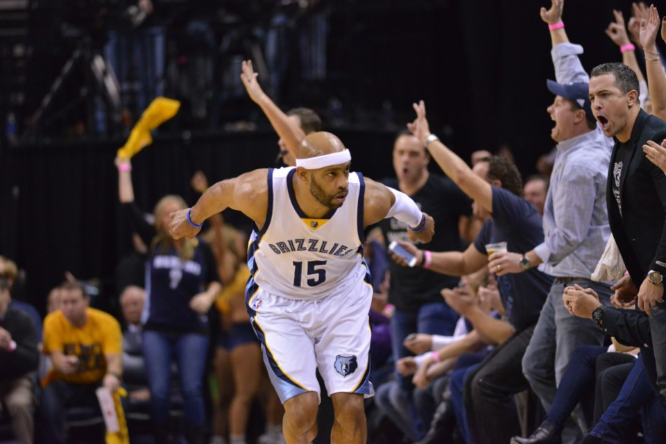 <strong>Memphis Grizzlies guard Vince Carter runs past fans after making a three-point shot during a game against Golden State, Dec. 16, 2014, in Memphis.</strong> (AP Photo/Brandon Dill file)