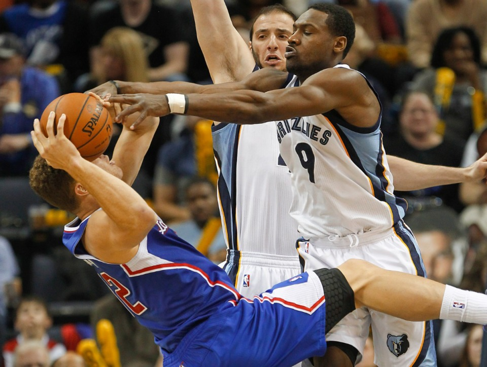 <strong>Memphis Grizzlies guard Tony Allen (9) and center Kosta Koufos, back, block a shot attempt by Los Angeles Clippers forward Blake Griffin, left, in a game, Feb. 21, 2014, in Memphis. The Grizzlies won 102-96.</strong> (AP Photo/Lance Murphey file)