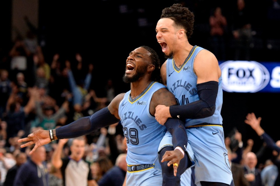 <strong>Memphis Grizzlies forward Jae Crowder (99) and guard Dillon Brooks react after Crowder scored the winning three-point basket as time expired during overtime of an NBA basketball game against the Brooklyn Nets, Oct. 27, 2019, in Memphis.</strong> (AP Photo/Brandon Dill file)