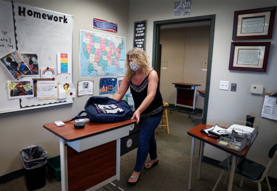 <strong>St. George&rsquo;s 8th grade American History teacher Traci Erlandson makes room for social distancing Friday, June 11, 2020. The coronavirus has put strain on teachers, schools and the education budget.</strong>&nbsp;(Mark Weber/Daily Memphian)