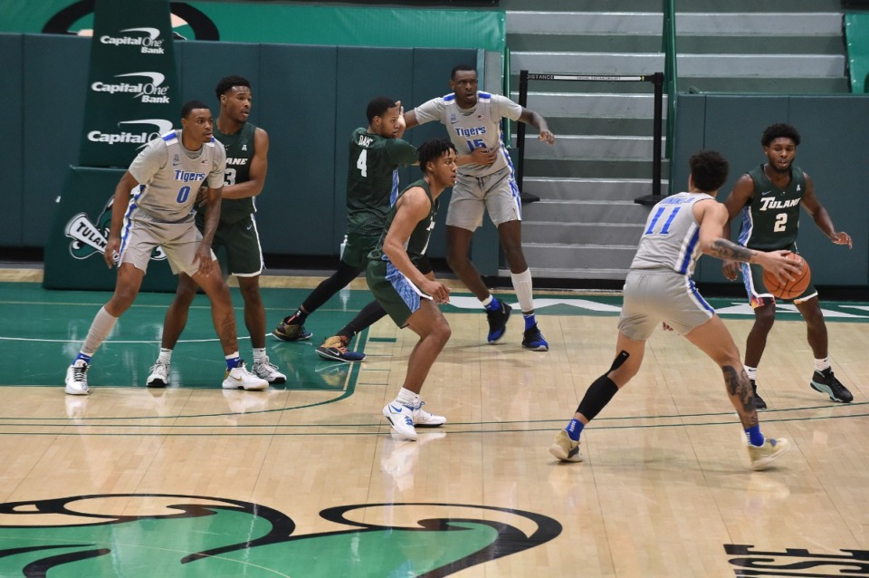 <strong>Memphis guard Lester Quinones (11) looks to pass in the Tigers&rsquo; 80-74 win over Tulane on Dec. 16, 2020.</strong> (Courtesy Tulane)