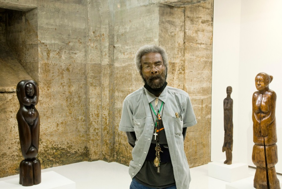 <strong>Artist Luther Hampton stands among his sculptures in Tops Gallery. Four of 13 pieces in the Tops show will soon go to the collections at Memphis Brooks Museum of Art and the Baltimore Museum of Art. Another piece, at a companion exhibition installed in the Tops space at Madison Avenue Park, will go to the Tennessee State Museum.</strong> (Courtesy of Matt Ducklo)