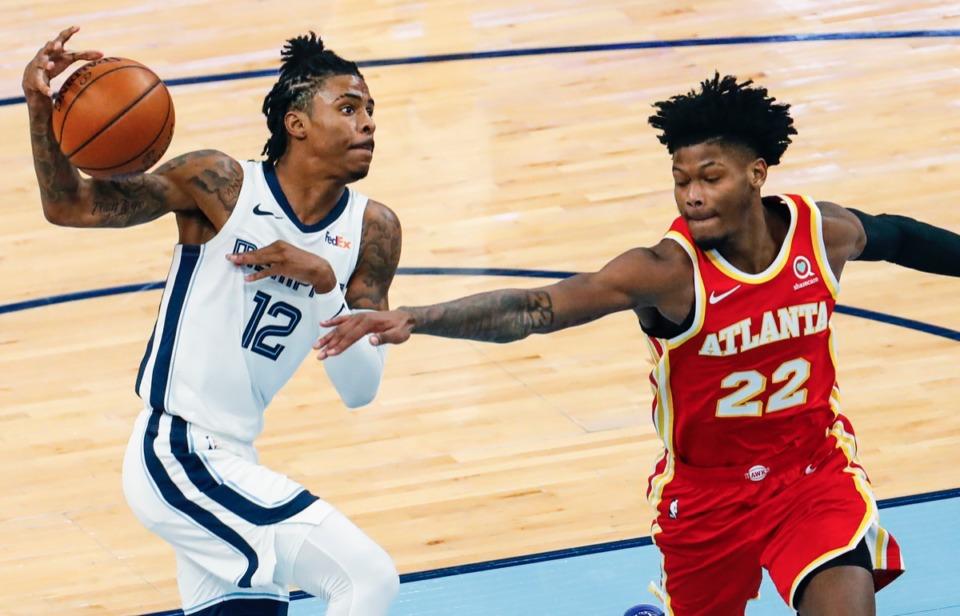 <strong>Memphis Grizzlies guard Ja Morant (left) drives the lane against Atlanta Hawks defender Cam Reddish (right) on Thursday, Dec. 17, 2020.</strong> (Mark Weber/The Daily Memphian)