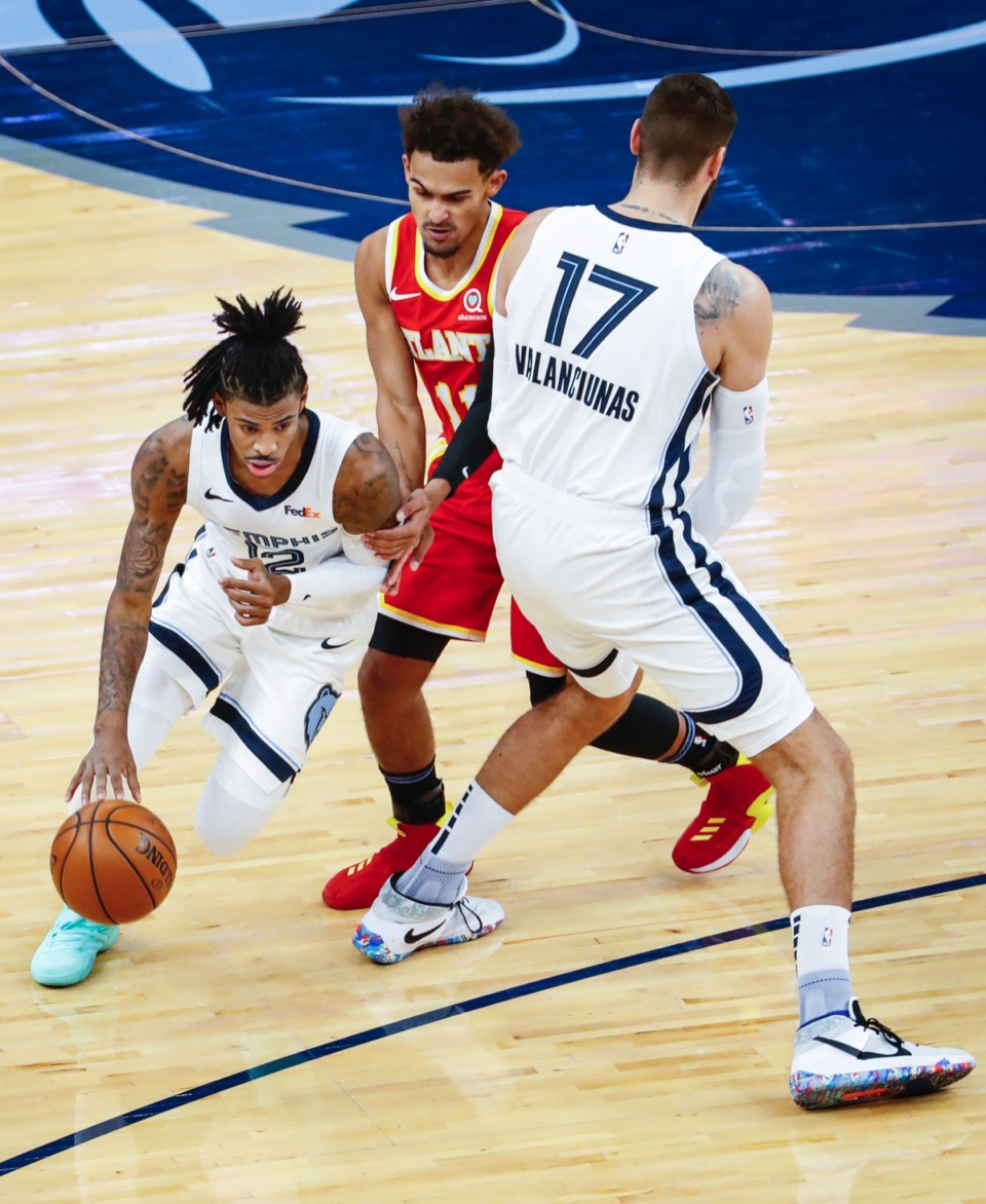 <strong>Memphis Grizzlies guard Ja Morant (left) drives around Atlanta&rsquo;s Trae Young (right) off the pick from teammate Jonas Valanciunas (right) on Thursday, Dec. 17, 2020.</strong> (Mark Weber/The Daily Memphian)