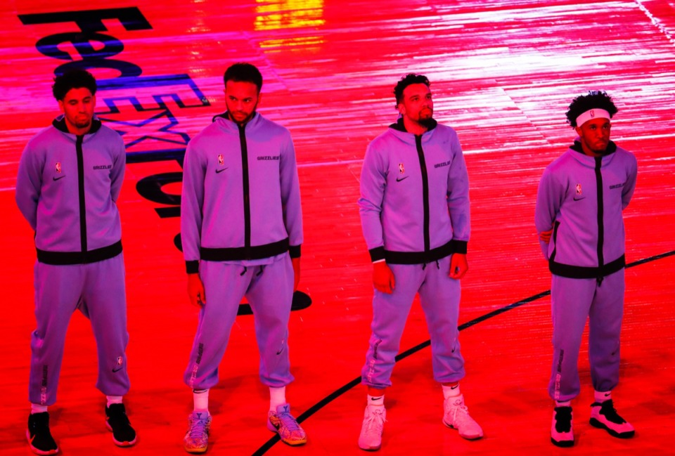<strong>Memphis Grizzlies guard Dillon Brooks (second left) stands with his teammates during the national anthem before the game against the Atlanta Hawks on Thursday, Dec. 17, 2020.</strong> (Mark Weber/The Daily Memphian)