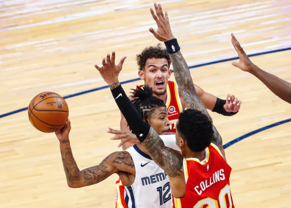 <strong>Memphis Grizzlies guard Ja Morant (middle) makes a pass while driving the lane against Atlanta&rsquo;s Trae Young (top) and John Collins (bottom) on Dec. 17, 2020.</strong> (Mark Weber/The Daily Memphian)