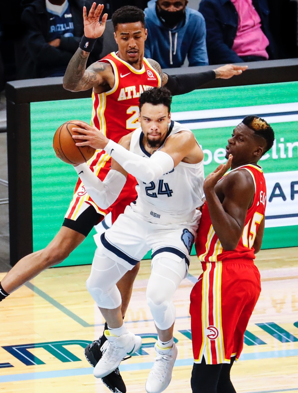 <strong>Grizzlies guard Dillon Brooks (middle) looks to make a pass after driving the lane against Atlanta&rsquo;s John Collins (top) and Clint Capela (right).</strong> (Mark Weber/The Daily Memphian)