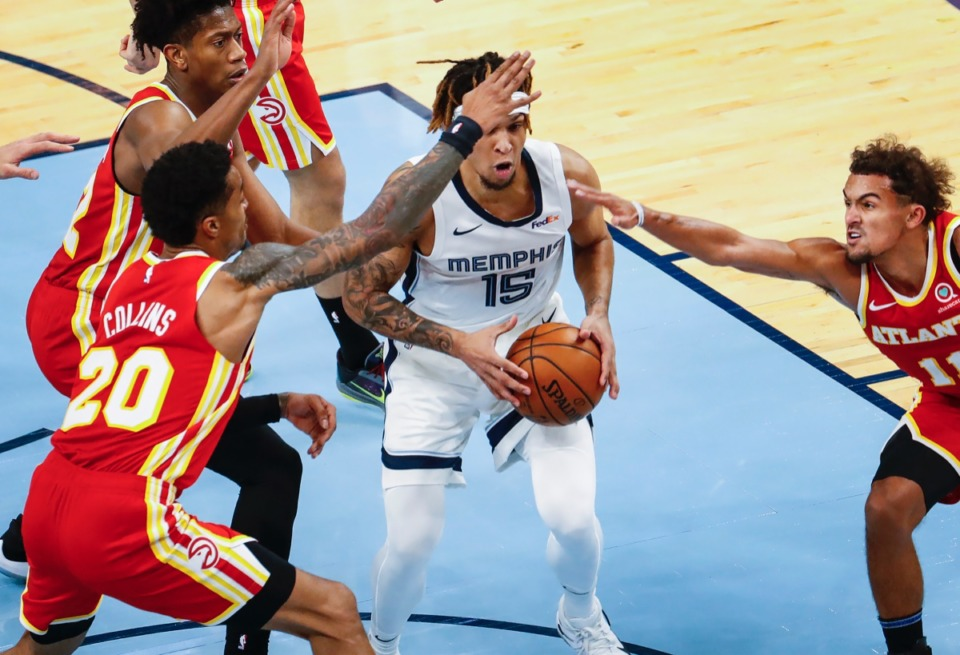 <strong>Grizzlies forward Brandon Clarke (middle) grabs a rebound against the Hawks on Dec. 17, 2020.</strong> (Mark Weber/The Daily Memphian)