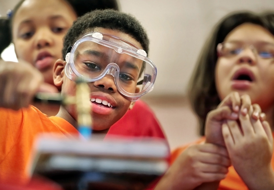 "<p class=""p1""><strong>Rozelle Elementary fifth grader Malcolm Washington learns how to anneal a piece of copper with a welding torch as part of a community outreach program&nbsp; with local artists in the fall. Shelby County's new position of&nbsp;education director, to which Cedrick Gray has been appointed, was created to act as a liaison between county government, Shelby County Schools, the six suburban municipal school districts and the superintendents of those seven public school systems.&nbsp;</strong>(Jim Weber/Daily Memphian file)"