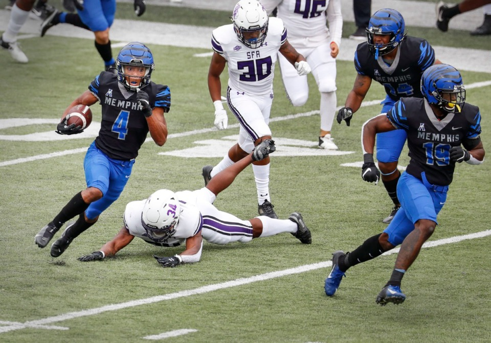 <strong>Calvin Austin III (left) runs past the Stephen F. Austin defense for a touchdown on Saturday, Nov. 21, 2020. Coach Ryan Silverfield said he&rsquo;s good to go after it looked like he got hurt on one of Memphis&rsquo; final offensive plays against Houston.</strong> (Mark Weber/The Daily Memphian)