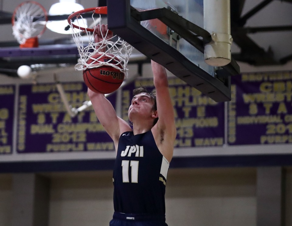 <strong>Pope John Paul II forward Sam Specht goes for a dunk against CBHS on Dec. 18.</strong> (Patrick Lantrip/Daily Memphian)