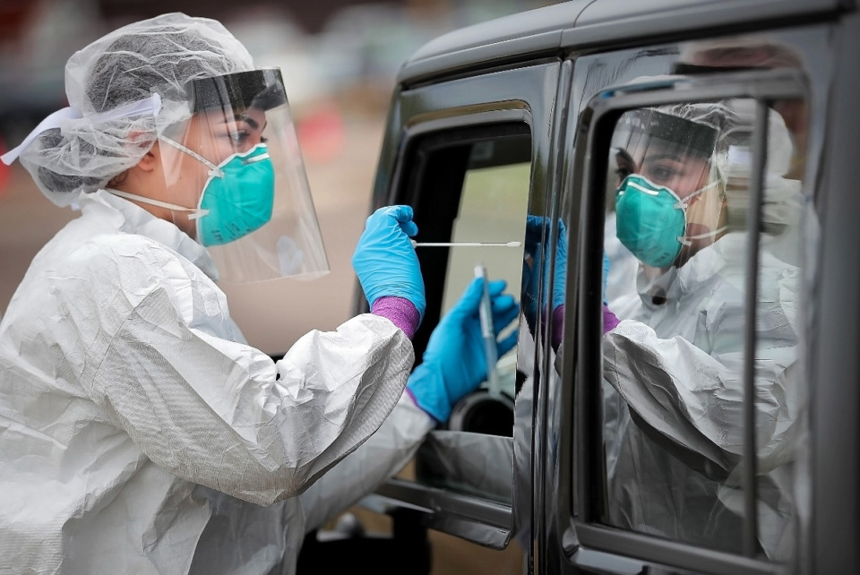<strong>National Guard medics collect nasal swabs in April. Shelby County reported more than 750 cases and 21 deaths in its Saturday update. </strong>(Jim Weber/Daily Memphian)