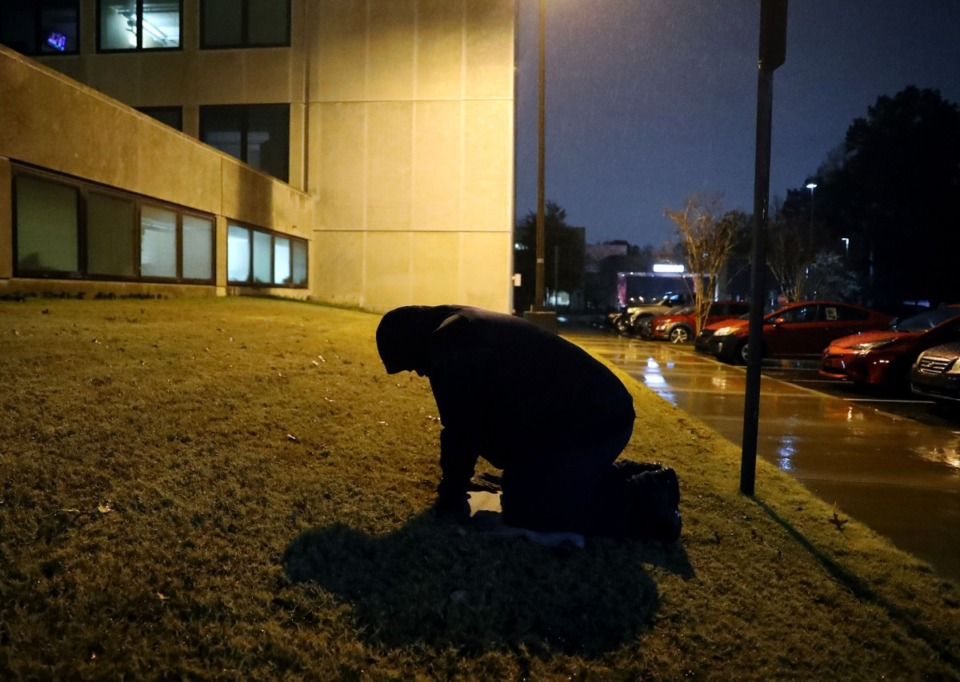 <strong>Darrell Cobbins prayed outside Baptist Memorial Hospital emergency room after his brother Donnell died from COVID-19 complications Dec. 11, 2020.</strong> (Patrick Lantrip/Daily Memphian)