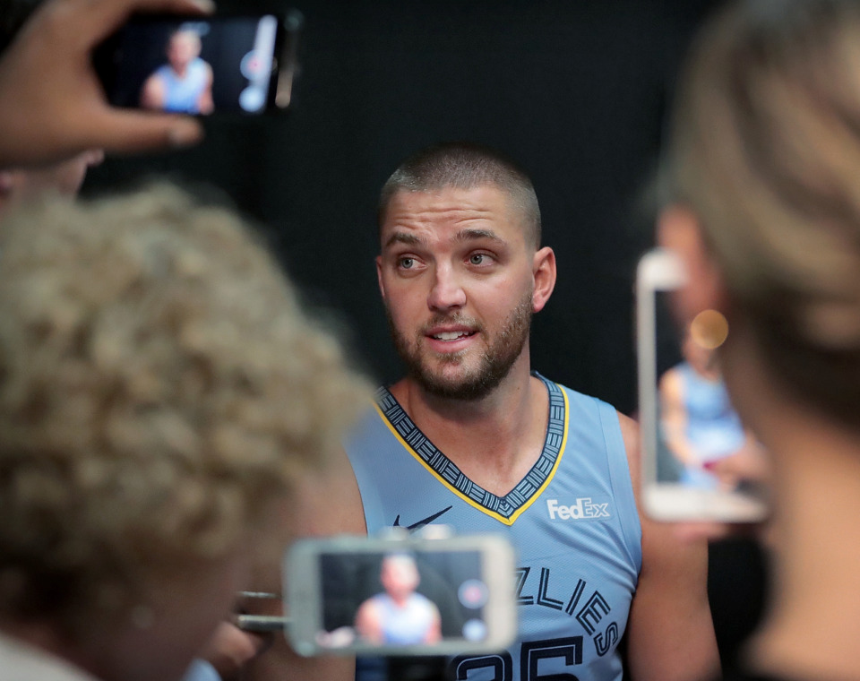 <strong>Chandler Parsons fields questions by a crowd of phone wielding reporters during the annual Grizzlies media day at the FedExForum on September 24, 2018.</strong> (Jim Weber/Daily Memphian)
