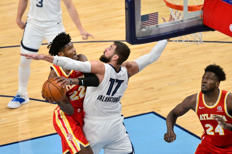 <strong>Atlanta Hawks forward Cam Reddish (22) drives against Memphis Grizzlies center Jonas Valanciunas (17) in the second half of an NBA preseason basketball game Saturday, Dec. 19, 2020, at FedExForum.</strong> (Brandon Dill/AP)