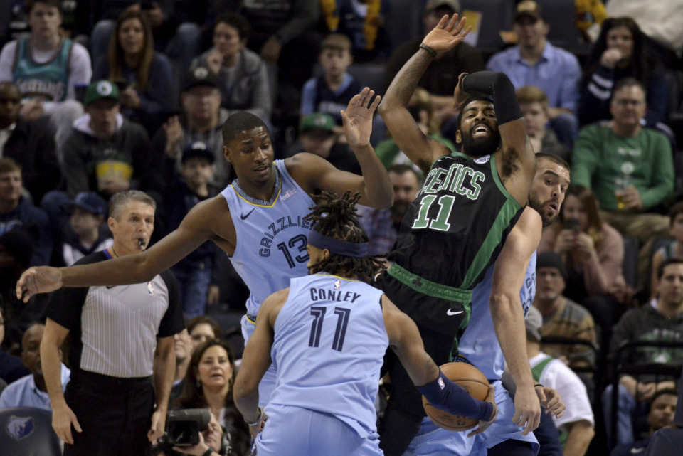 <strong>Memphis Grizzlies forward Jaren Jackson Jr. (13), Boston Celtics guard Kyrie Irving (11), and Grizzlies center Marc Gasol, right, collide as Grizzlies guard Mike Conley (11) controls the ball during the first half of an NBA&nbsp; game Saturday, Dec. 29, 2018, in Memphis.</strong> (AP Photo/Brandon Dill)