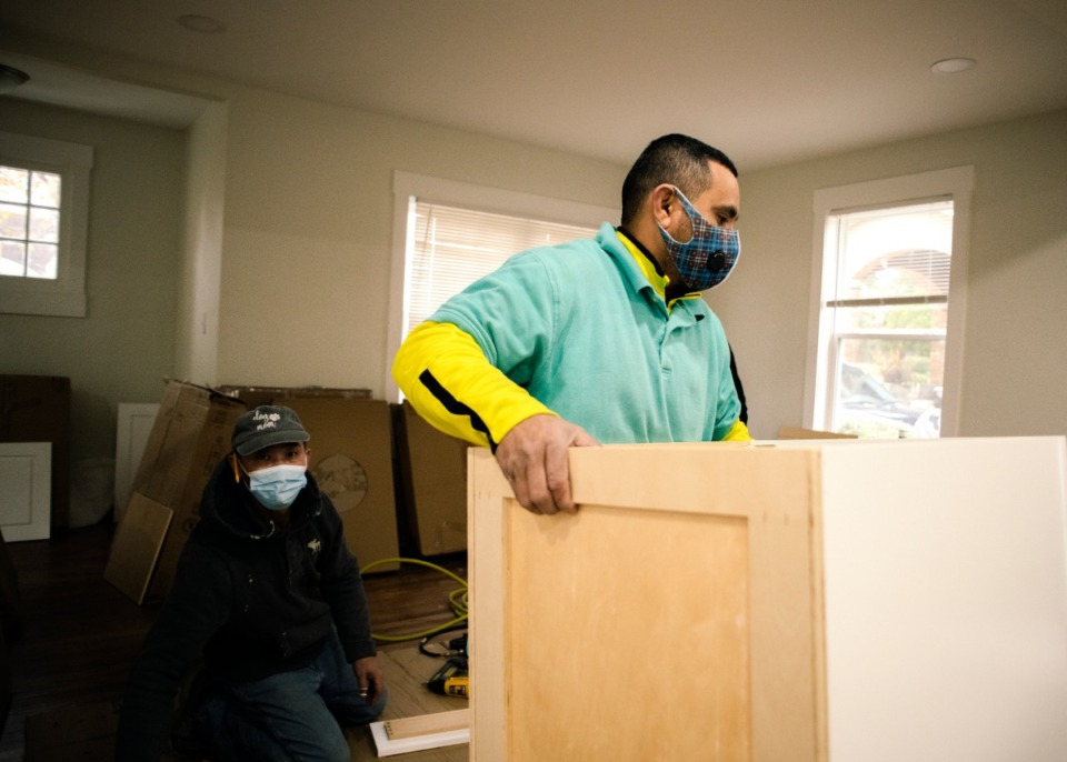 <strong>Vladimir Aguilar is installing a new kitchen in Matt Wallace of The Wallace Group at Keller Williams Realty bought to renovate and resell.</strong> (Houston Cofield/Special Daily Memphian)