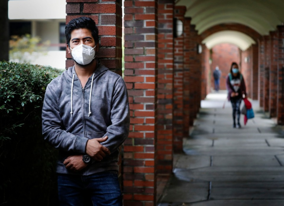 <strong>Christian Brothers University is delaying the start of spring semester two weeks, hoping to avoid a spike in the virus predicted after the Christmas and New Year&rsquo;s holidays. Fnu Syed Masood Hyder (in a file photo), a CBU computer science senior from India, quarantined for two weeks upon his arrival for fall class in August.</strong> (Mark Weber/The Daily Memphian)