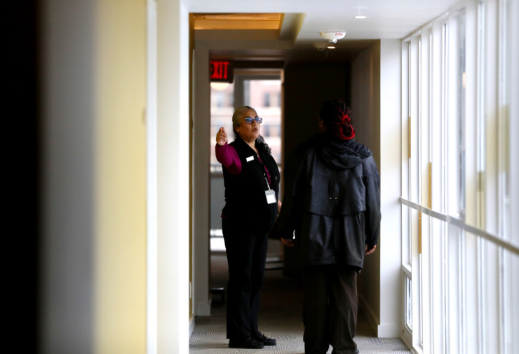 <strong>Lucy Santana (left), executive housekeeper at Hotel Indigo, gives a tour to a potential employee. As part of the boutique hotel's musical theme, the hotel's 50 employees will share their favorite Memphis artists with guests. Employee nametags will list the employee's favorite Memphis artist. </strong>(Houston Cofield/Daily Memphian)