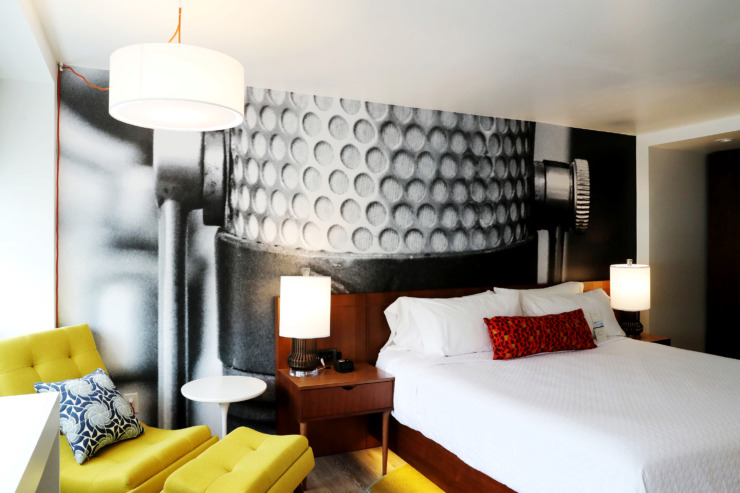 "<strong>Guest rooms at Hotel Indigo contain a music-inspired vinyl wall that pays homage to the city's musical heritage. ""The furnishings, the building itself, it's all retro,"" said general manager Patrick Jordan. ""We're hitting on all cylinders to give people a real Memphis vibe.""</strong>  (Houston Cofield/Daily Memphian)"