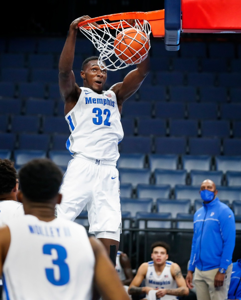 <strong>Memphis center Moussa Cisse dunks on the Tulsa defense during action on Monday, Dec. 21, 2020.</strong> (Mark Weber/The Daily Memphian)