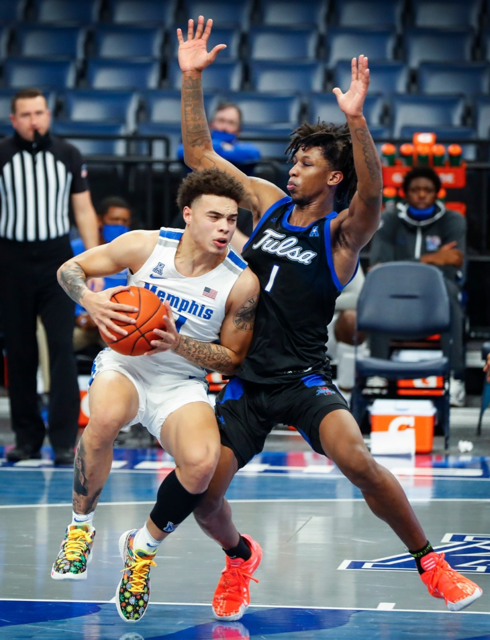 <strong>Memphis guard Lester Quinones (left) drives the lane against Tulsa defender Brandon Rachal (right) during action on Monday, Dec. 21, 2020.</strong> (Mark Weber/The Daily Memphian)