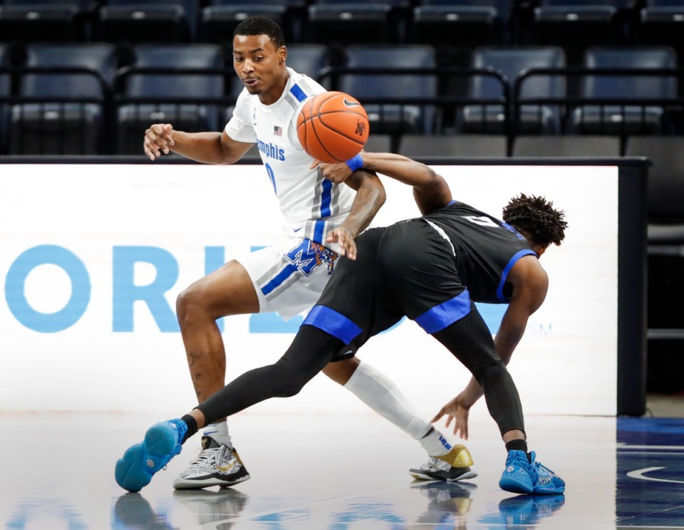 <strong>Memphis forward D.J. Jeffries (top) knocks the ball away from Tulsa guard Curtis Haywood II (right) during action on Monday, Dec. 21, 2020.</strong> (Mark Weber/The Daily Memphian)