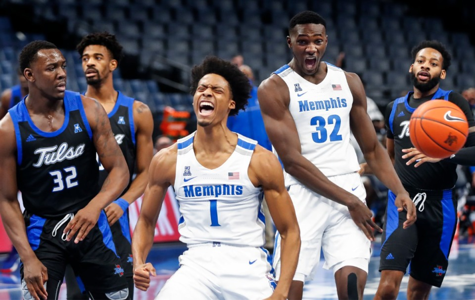 <strong>Memphis guard Jayden Hardaway (middle) celebrates a fast-break dunk against the Tulsa defense during action on Monday, Dec. 21, 2020.</strong> (Mark Weber/The Daily Memphian)