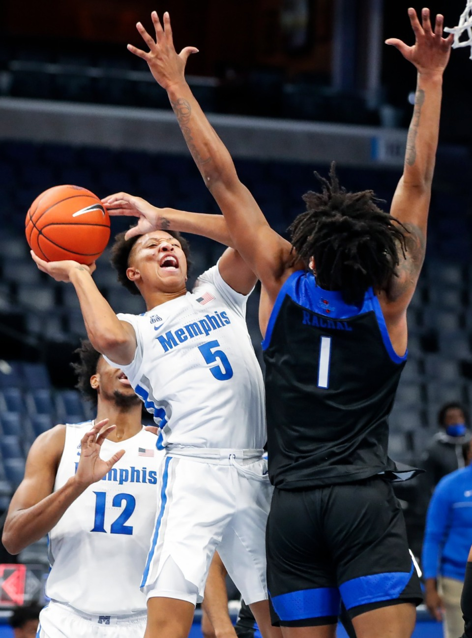 <strong>Memphis guard Boogie Ellis (left) drives the lane against Tulsa defender Brandon Rachal (right) during action on Monday, Dec. 21, 2020.</strong> (Mark Weber/The Daily Memphian)