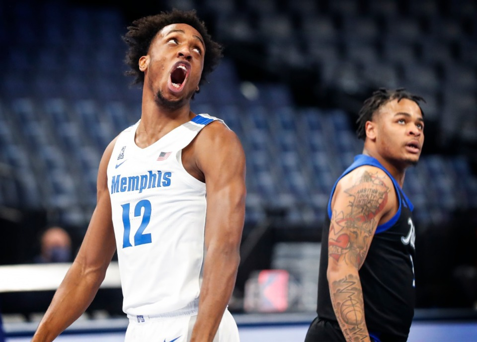 <strong>Memphis forward DeAndre Williams (left) celebrates a made Bakst while being fouled by the Tulsa defense during action on Monday, Dec. 21, 2020.</strong> (Mark Weber/The Daily Memphian)