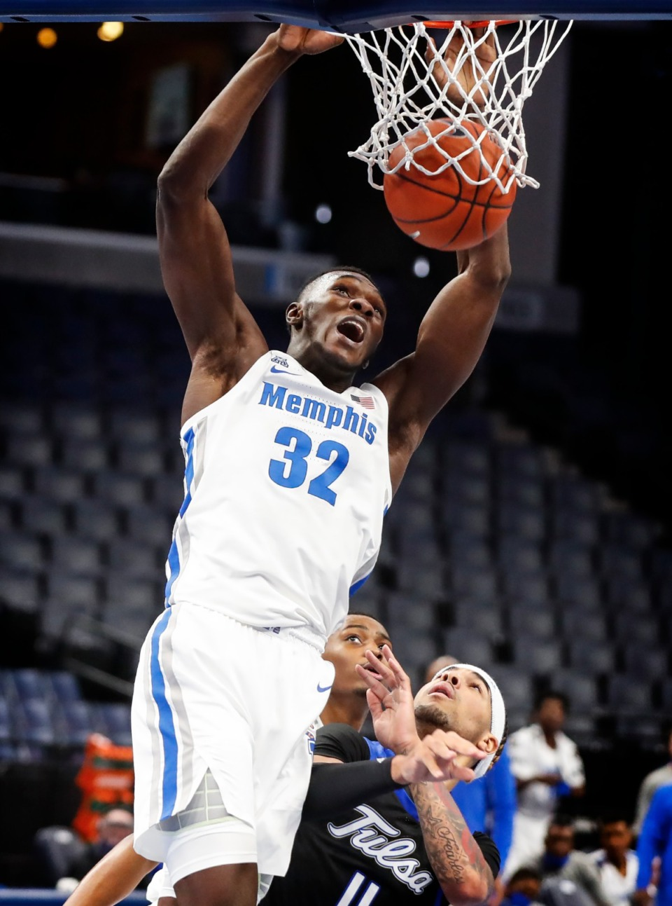 <strong>Memphis center Moussa Cisse (top) finishes a dunk against the Tulsa defense during action on Monday, Dec. 21, 2020.</strong> (Mark Weber/The Daily Memphian)