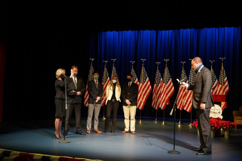<strong>Rep. Kevin Vaughan administers the oath of office&nbsp; for Collierville Alderwoman Missy Marshall on Monday, Dec. 21, at The Harrell Performing Arts Theatre. Marshall was one of four board members sworn in Monday.</strong> (Courtesy of Cindy Thymius)