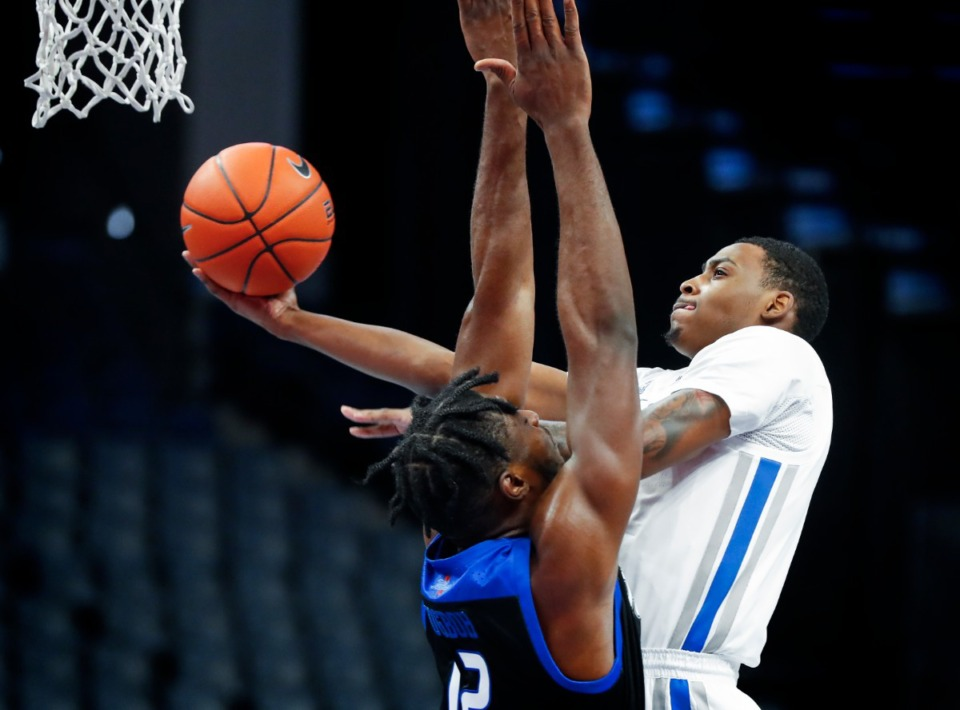 <strong>Memphis forward D.J. Jeffries (right) drives to the basket against Tulsa defender Emmanuel Ugboh (left) during action on Monday, Dec. 21, 2020.</strong> (Mark Weber/The Daily Memphian)