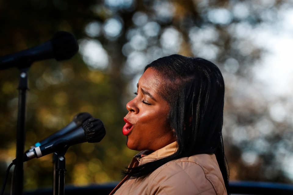 <strong>Opera Memphis singer Tanisha Ward performs to a small crowd from a flatbed truck during an outdoor Collierville neighborhood performance on Monday, Dec. 21, 2020.</strong> (Mark Weber/The Daily Memphian)
