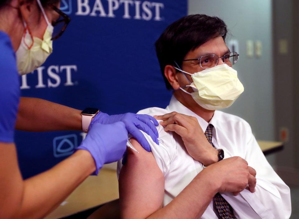 <strong>Dr. Manoj Jain gets a COVID-19 vaccination at Baptist Memorial Hospital on Thursday, Dec. 17.</strong> (Patrick Lantrip/Daily Memphian)