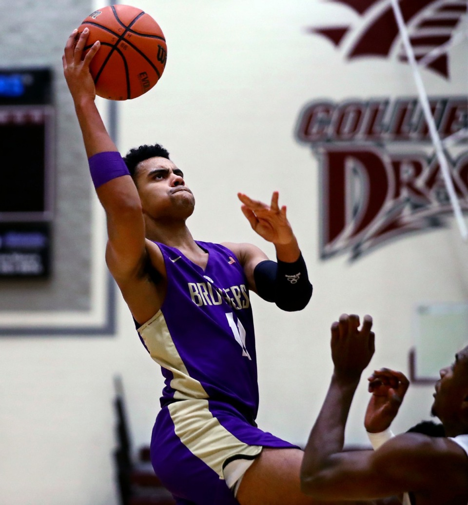 <strong>Christian Brothers guard Reese Mcmullen goes up for a layup against Collierville High on Tuesday, Dec. 22.</strong> (Patrick Lantrip/Daily Memphian)