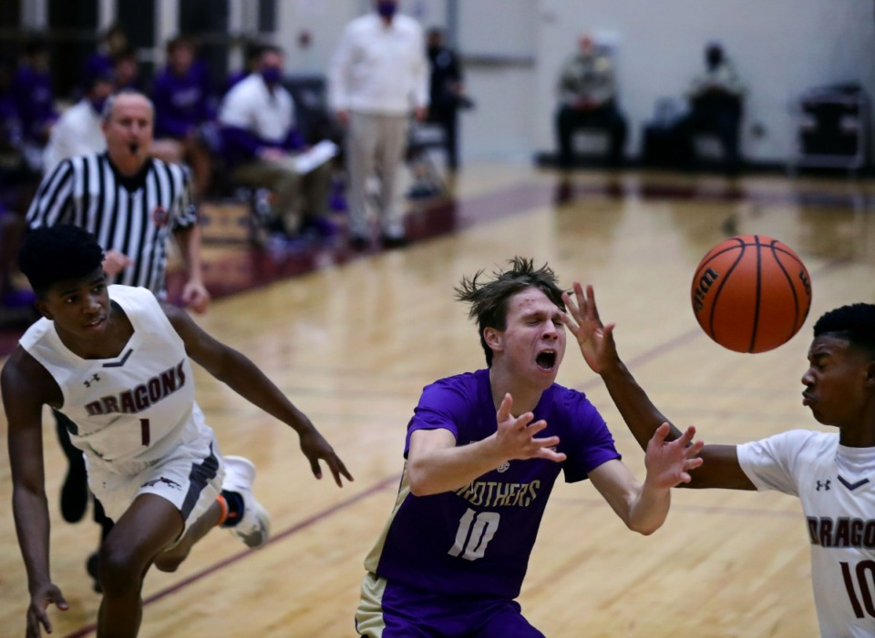 <strong>Christian Brothers guard Harrison Kelly (10) gets fouled on a fast break during a game against Collierville High on Tuesday, Dec. 22.</strong> (Patrick Lantrip/Daily Memphian)