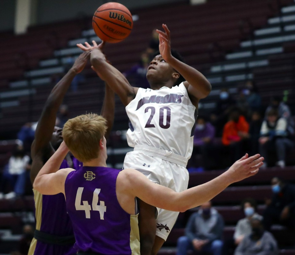 <strong>Collierville High guard Chris Sims (20) tries to go up for a layup during a game against Christian Brothers on Tuesday, Dec. 22.</strong> (Patrick Lantrip/Daily Memphian)