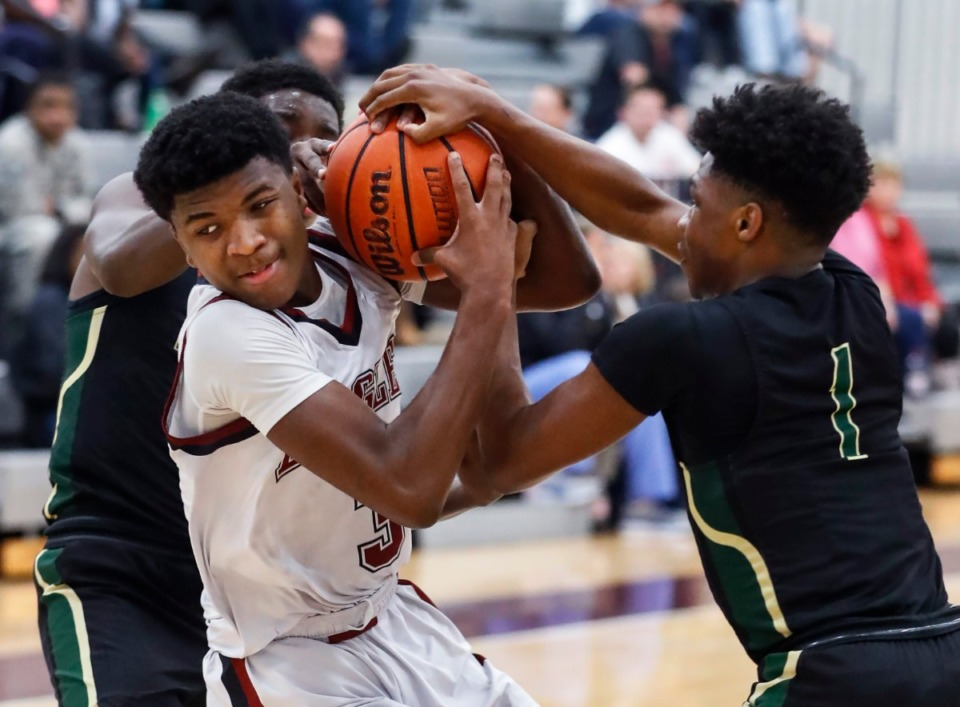 <strong>ECS guard Kam Jones (left) battles for a loose ball with FACS defender Kobe Wilkes (right) during action on Jan. 14, 2020.</strong> (Mark Weber/Daily Memphian file)