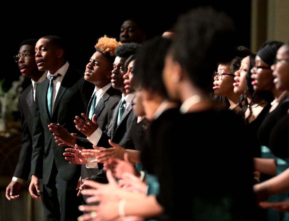 "<strong>The Cordova High School Choir sings a song of inspiration to open Memphis Mayor Jim Strickland's Prayer Breakfast for Memphis on Monday, Dec. 31, at the Holiday Inn University of Memphis. <span>Strickland urged the audience to become ""evangelists"" for the opportunity emerging in the city.</span></strong> (Houston Cofield/Daily Memphian)"
