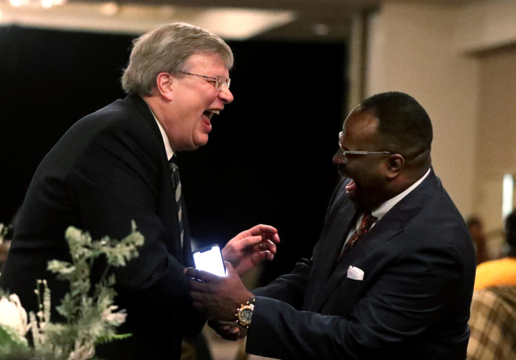 <strong>Memphis Mayor Jim Strickland greets guests at the Prayer Breakfast for Memphis. Strickland touted the role that religious communities have played in Memphis' history.</strong> (Houston Cofield/Daily Memphian)