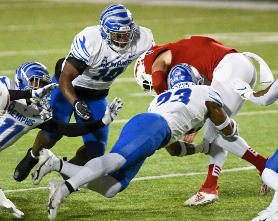 <strong>Memphis defenders make a tackle against Florida Atlantic Wednesday, Dec. 23, in the Montgomery Bowl in Montgomery, Ala.</strong> (Julie Bennett/Memphis Athletics)