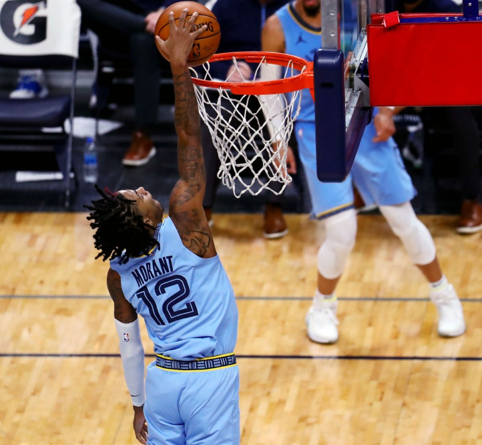 <strong>Memphis Grizzles guard Ja Morant goes up for a dunk during a Wednesday, Dec. 23, home game against the San Antonio Spurs.</strong> (Patrick Lantrip/Daily Memphian)