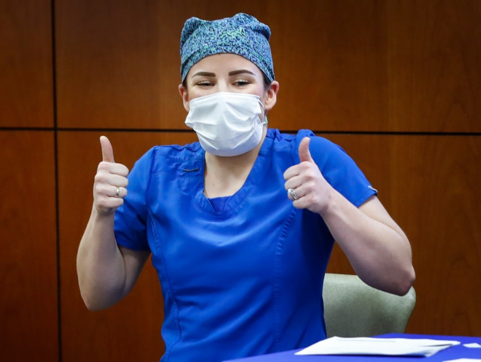 <strong>Baptist Memorial Hospital-DeSoto Intensive Care Unit head nurse Haley Griffiths gives a thumbs after receiving a COVID-19 vaccine shot on Wednesday, Dec. 16, 2020 in Southaven.</strong> (Mark Weber/The Daily Memphian)