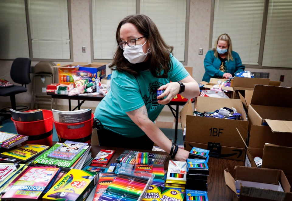 <strong>Baptist Memorial Hospital-Collierville staff members Courtney Ellis (front) and Kris Vaughan (back) fill care baskets with donated items on Thursday, Dec. 24. The gift baskets will be delivered to hospital patients on Christmas morning.</strong> (Mark Weber/Daily Memphian)