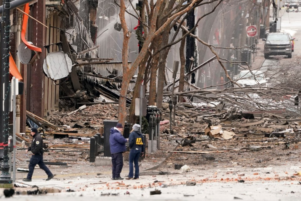 <strong>Emergency personnel work near the scene of an explosion in downtown Nashville, Friday, Dec. 25, 2020. Buildings shook in the immediate area and beyond after a loud boom was heard early Christmas morning.</strong> (Mark Humphrey/AP)