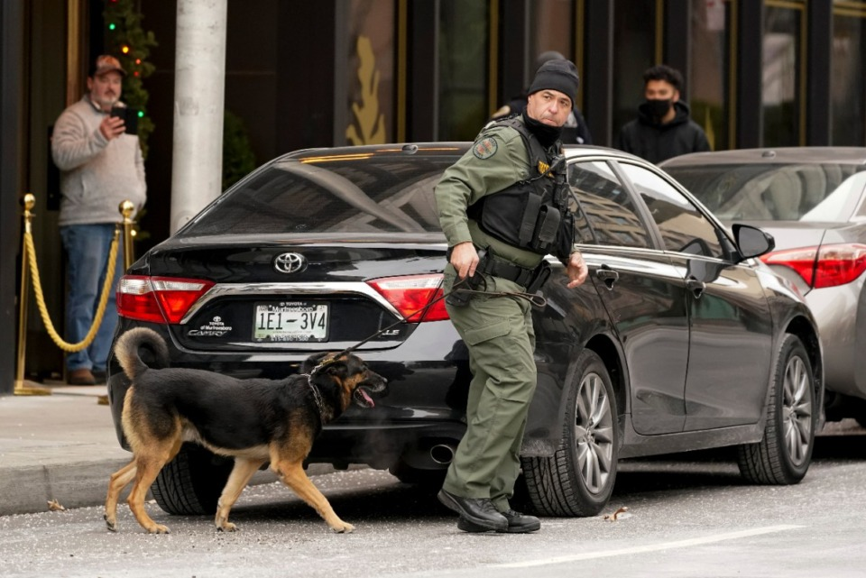 <strong>A K-9 team works in the area of an explosion in downtown Nashville, Friday, Dec. 25, 2020. Buildings shook in the immediate area and beyond after a loud boom was heard early Christmas morning.</strong> (Mark Humphrey/AP)