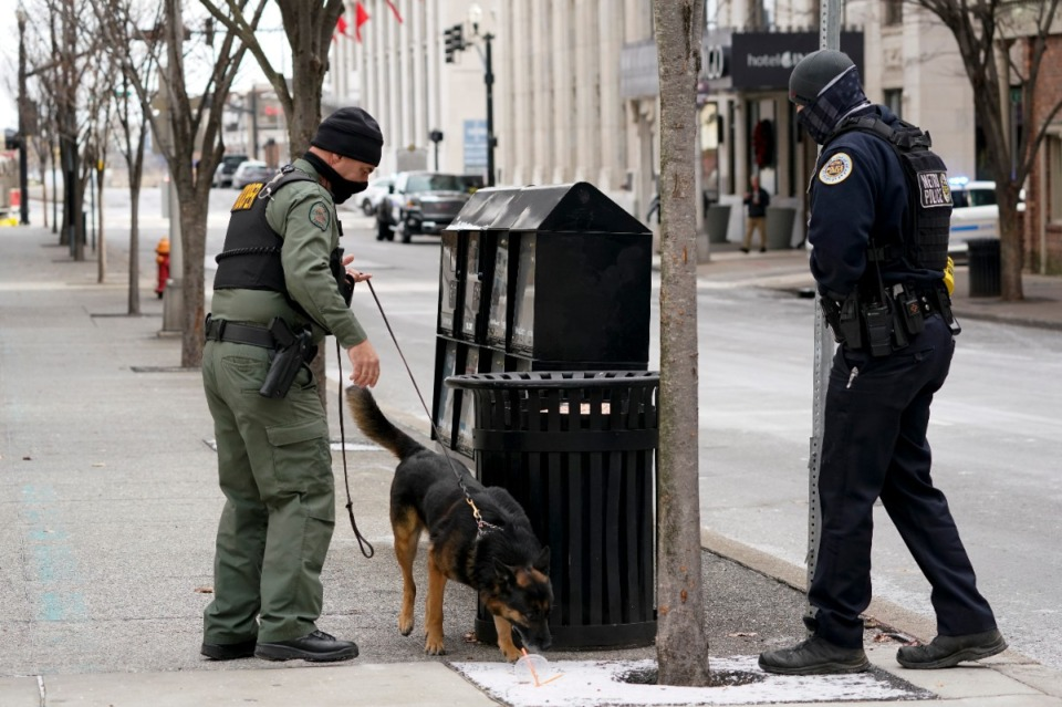 <strong>A K-9 team works in the area of an explosion in downtown Nashville,&nbsp; Friday, Dec. 25, 2020. Buildings shook in the immediate area and beyond after a loud boom was heard early Christmas morning. (Mark Humphrey/AP)</strong>