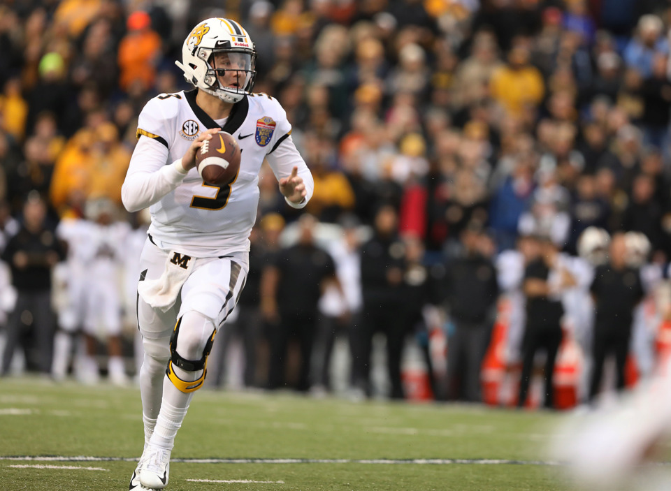 <strong>Missouri quarterback Drew Lock (3) directs traffic in the endzone as he scrambles from a defender in the first quarter of the AutoZone Liberty Bowl.</strong> (Patrick Lantrip/Daily Memphian)